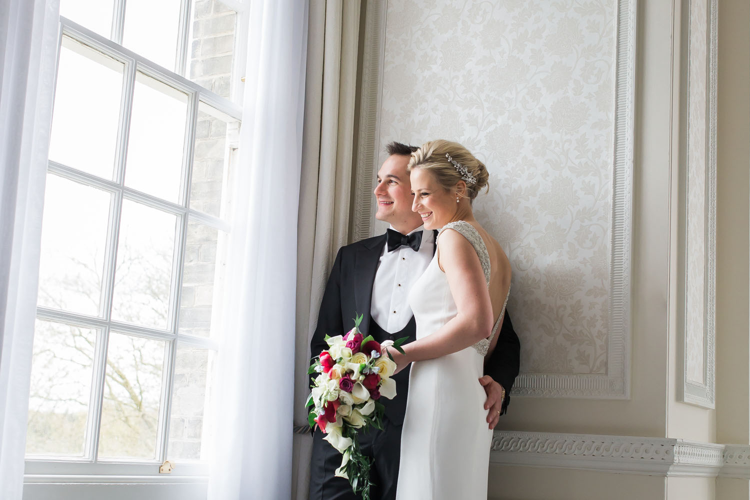 Bride and Groom at Hedsor House - window shot