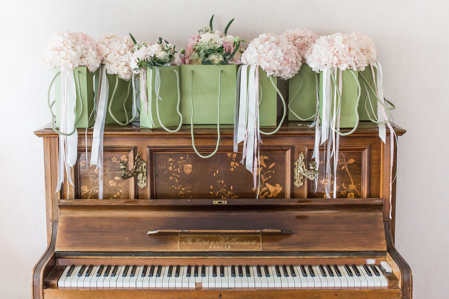 Beautiful bouquets on vintage piano