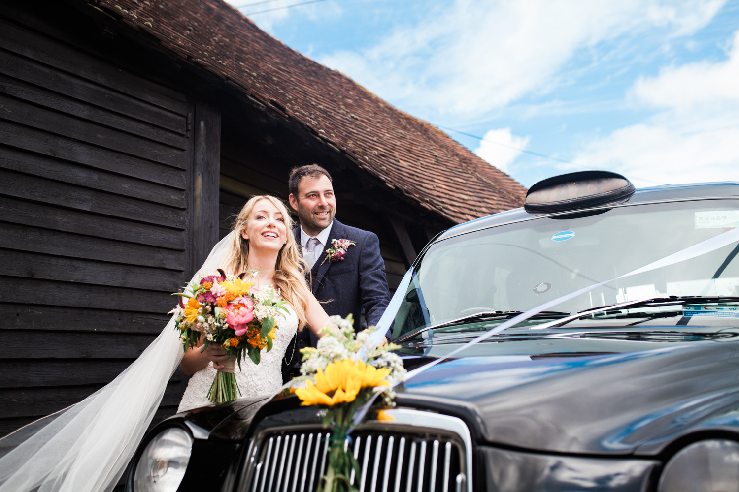 Bride and Groom - black cab shot