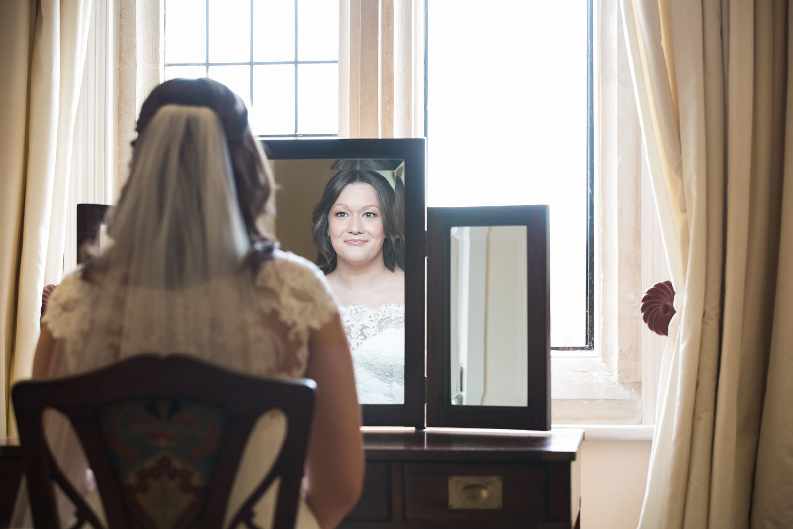 Notley Abbey Wedding - bride mirror shot