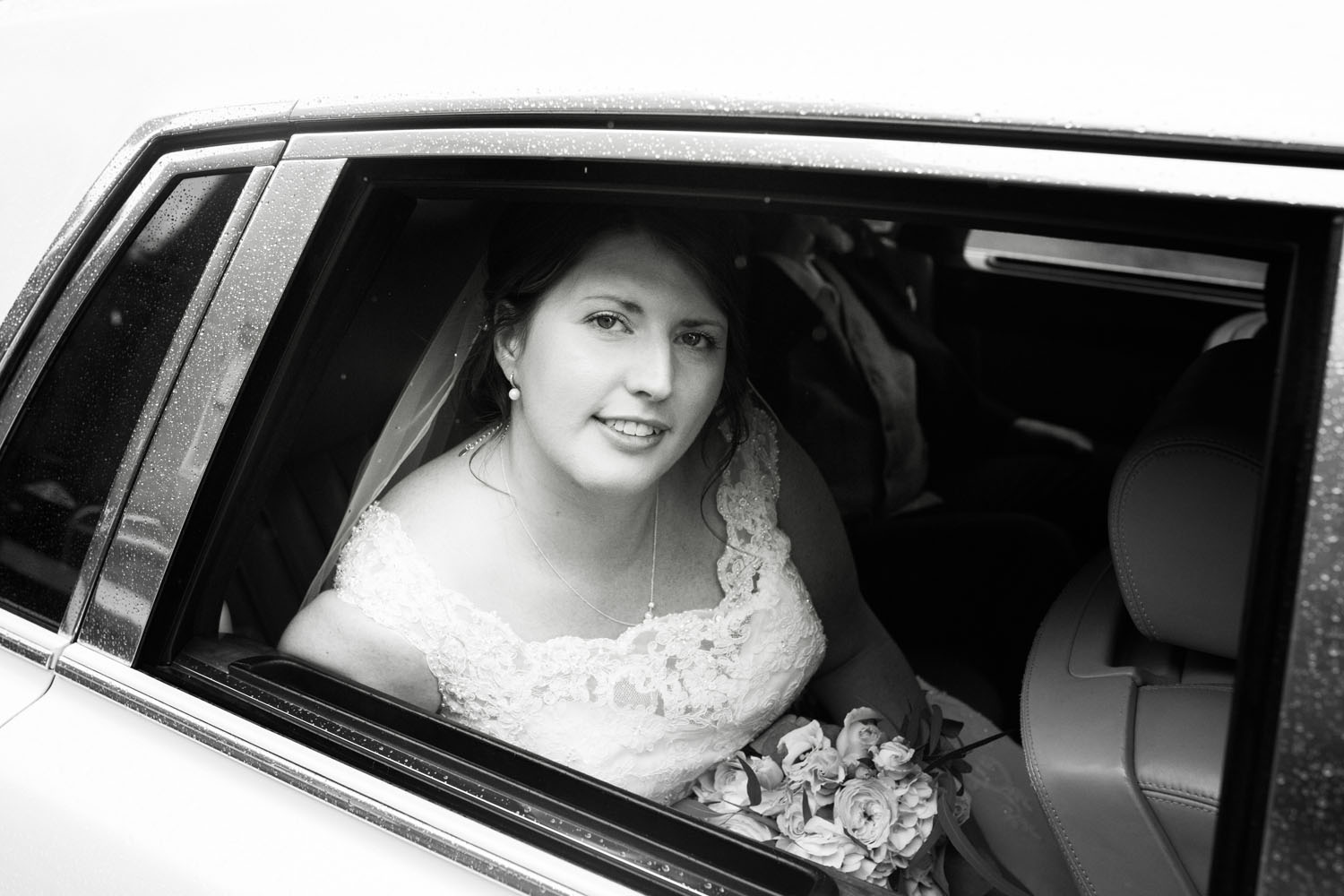 Bride in car at Latimer house