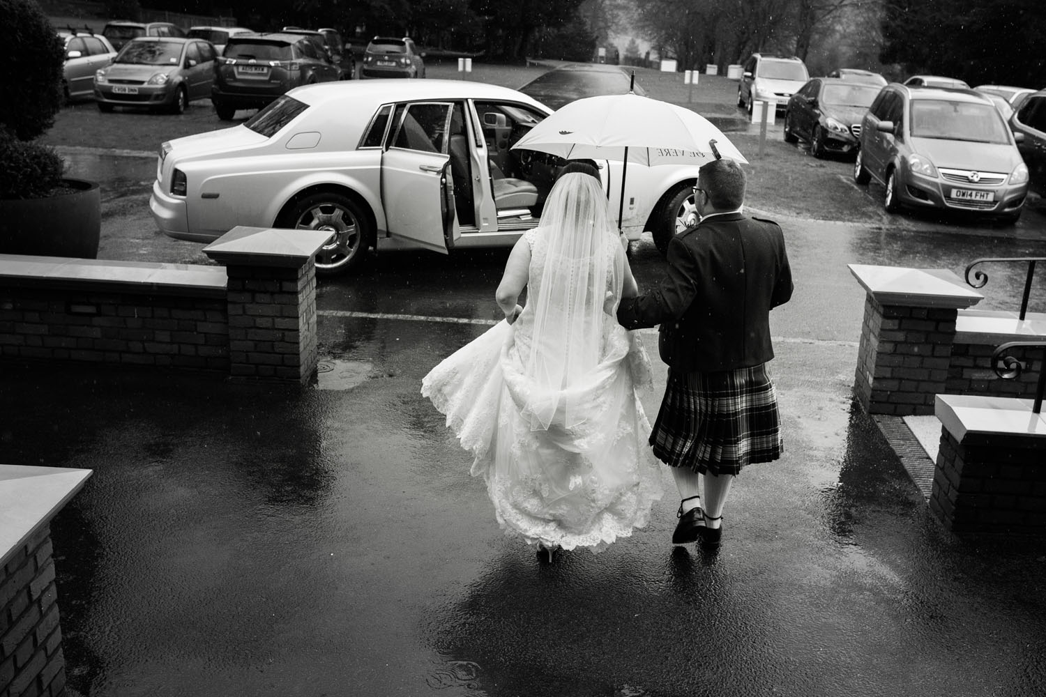 bride and groom in the rain - devere latimer