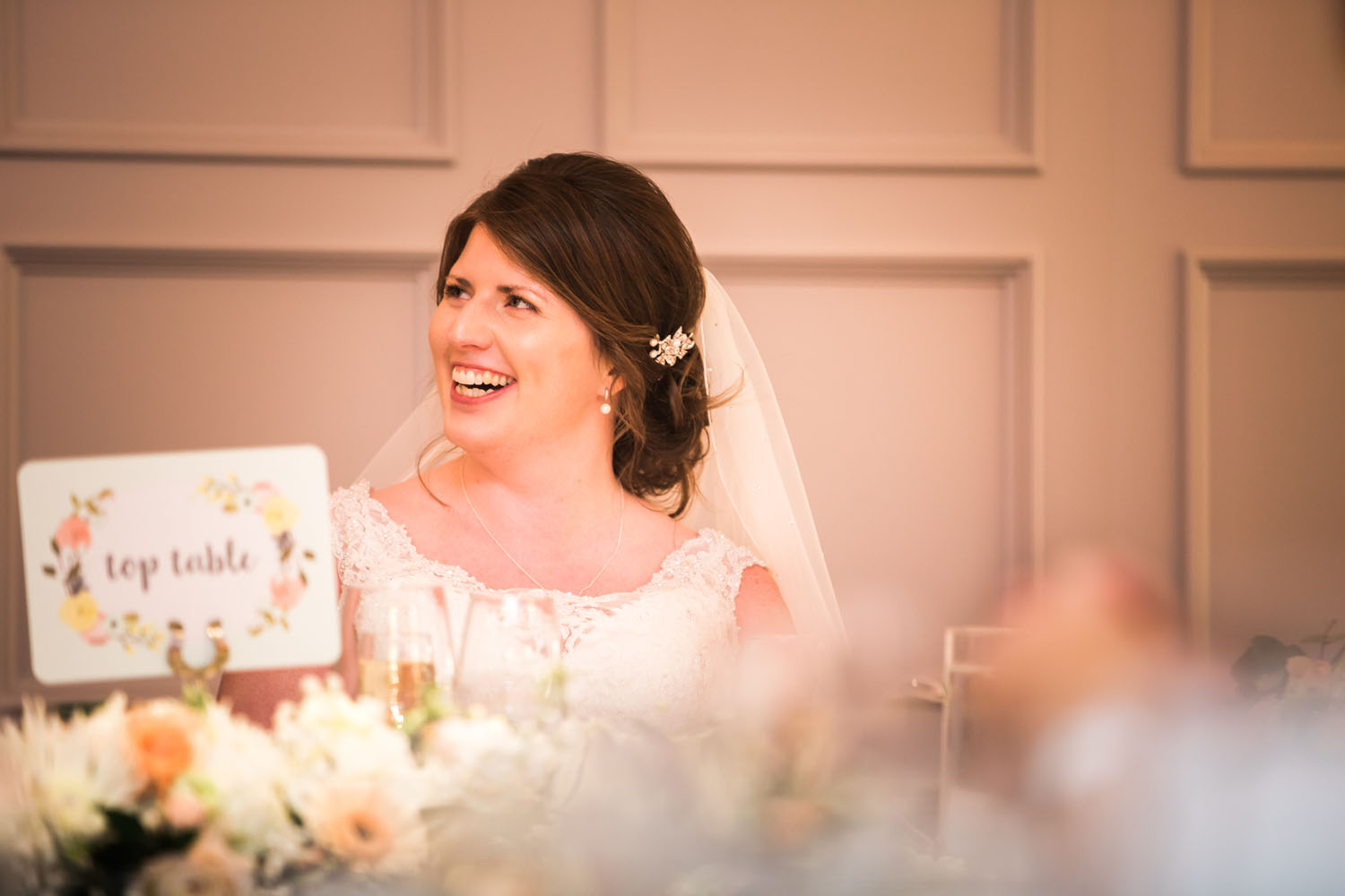 bride laughing at best man's speech