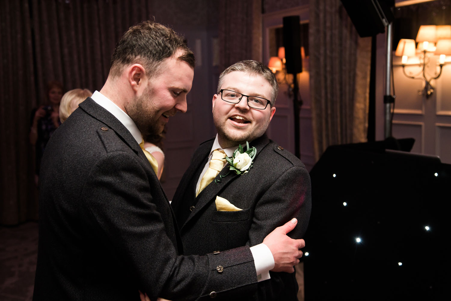 groom dancing with best man