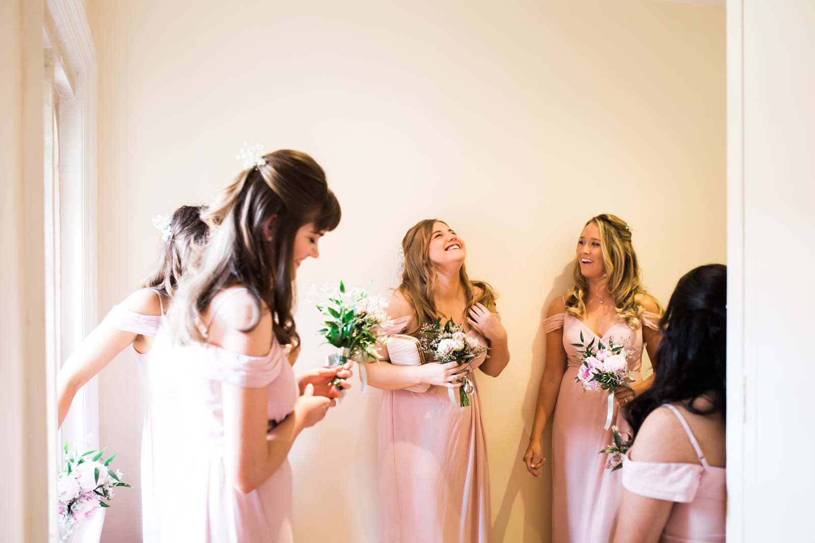 Notley Abbey wedding in Buckinghamshire bridesmaids laughing