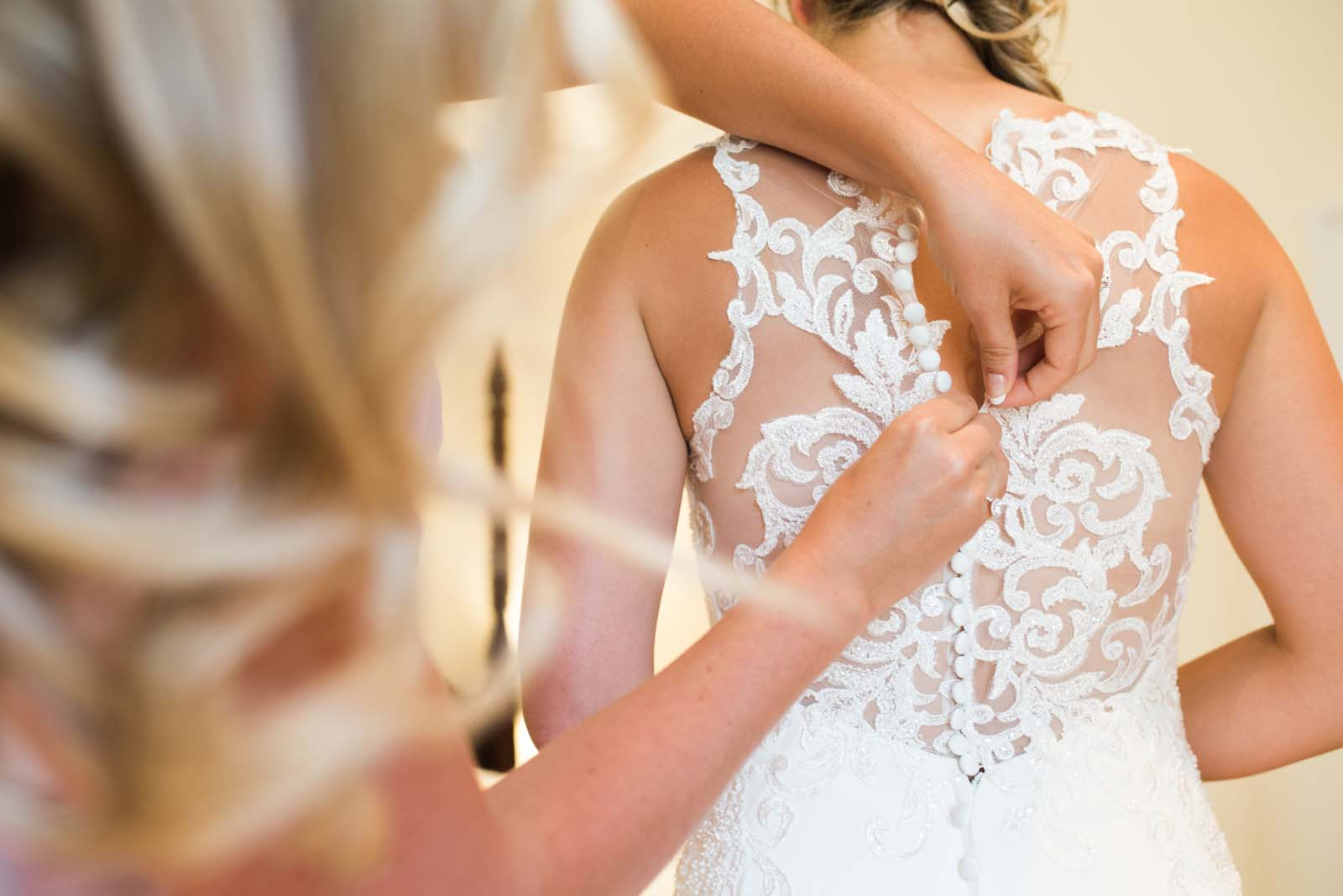 Notley Abbey wedding in Buckinghamshire final touches to the dress