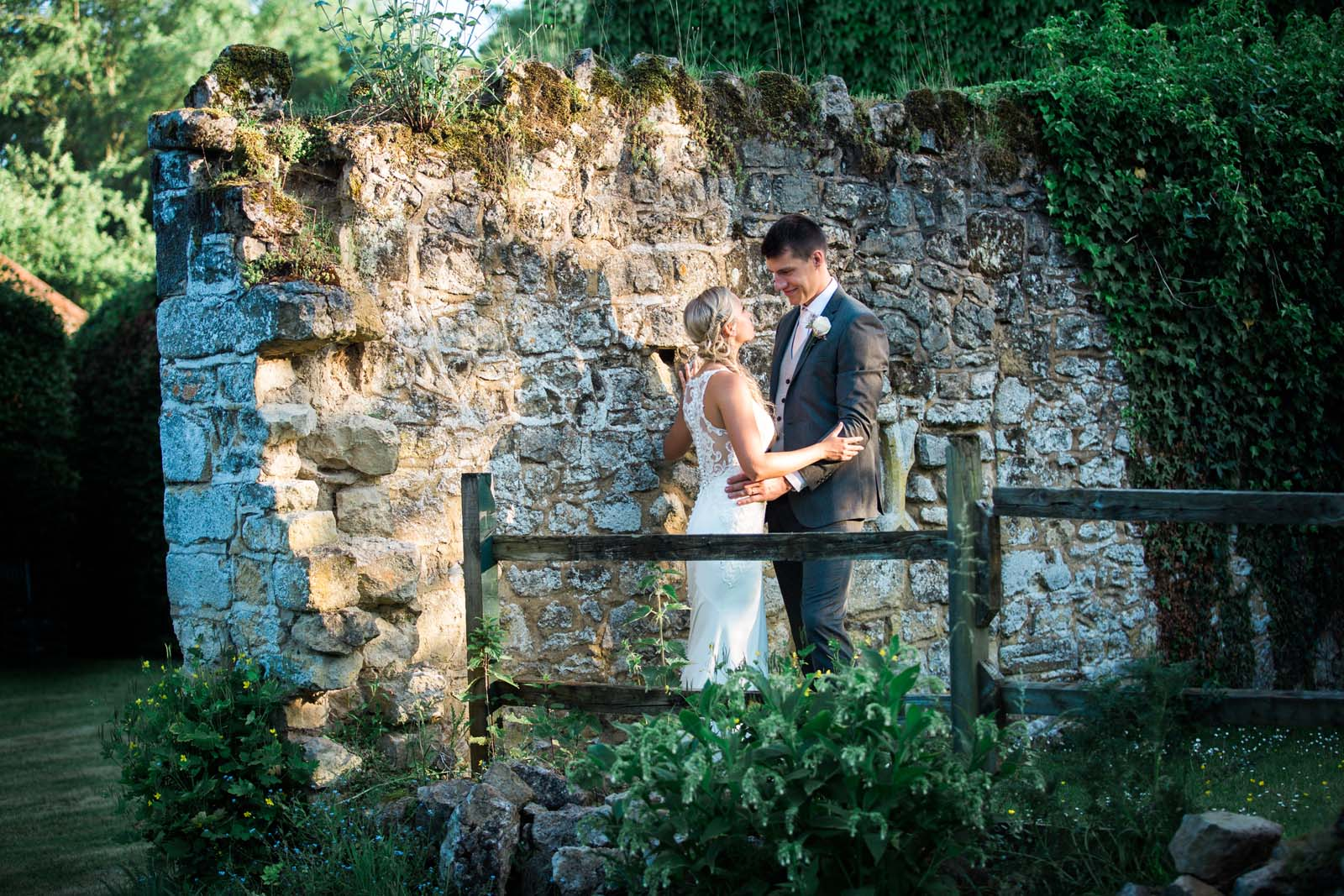 Notley Abbey wedding couple having a romantic moment in the walled garden