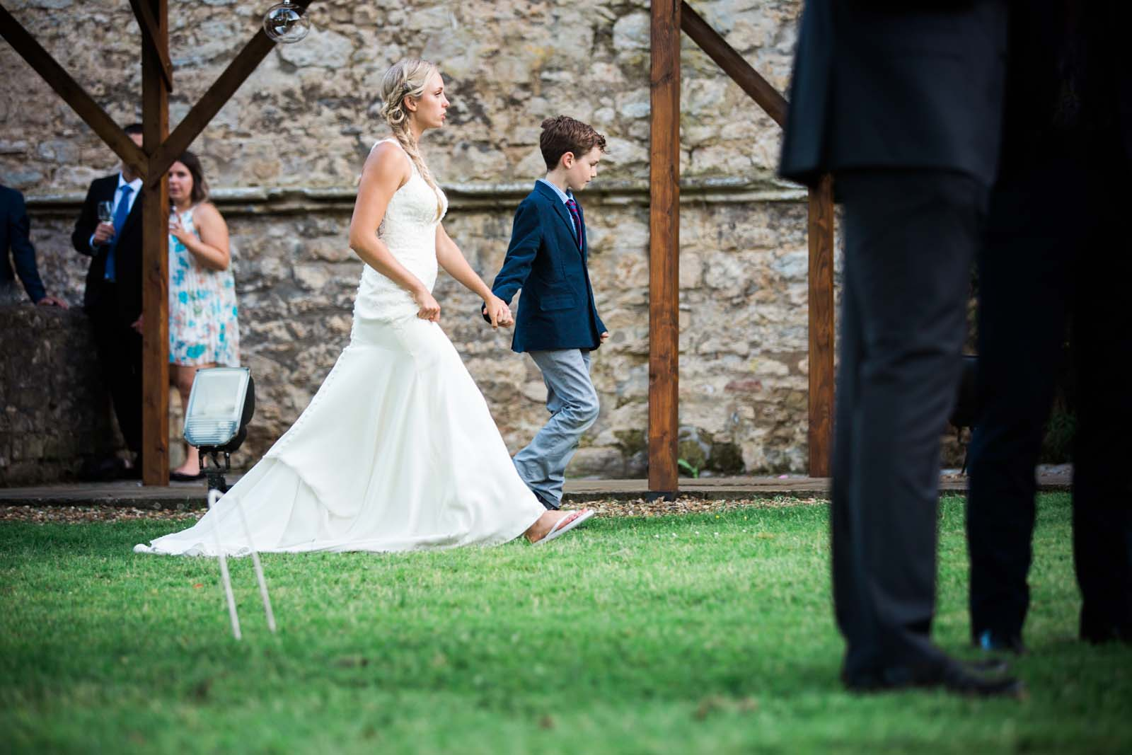 Notley Abbey Wedding Buckinghamshire Bride Walking with Young Guest