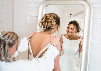 Bride at Hedsor House looking in the mirror - Heni Fourie Photography