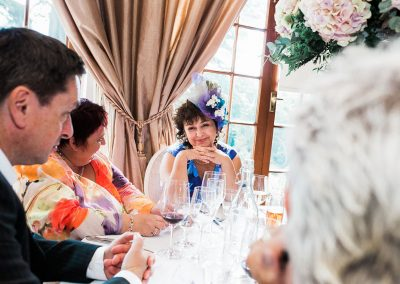 Wedding Photography - Smiling Wedding Guest at Hedsor House