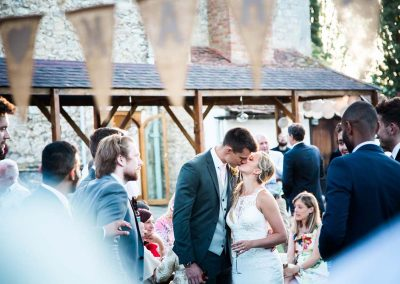 Groom Stealing a Kiss at Notley Abbey - Heni Fourie Photography