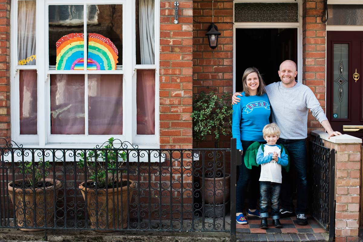 Happy family with rainbow in their window - Front Steps Photos Covid19 lockdown
