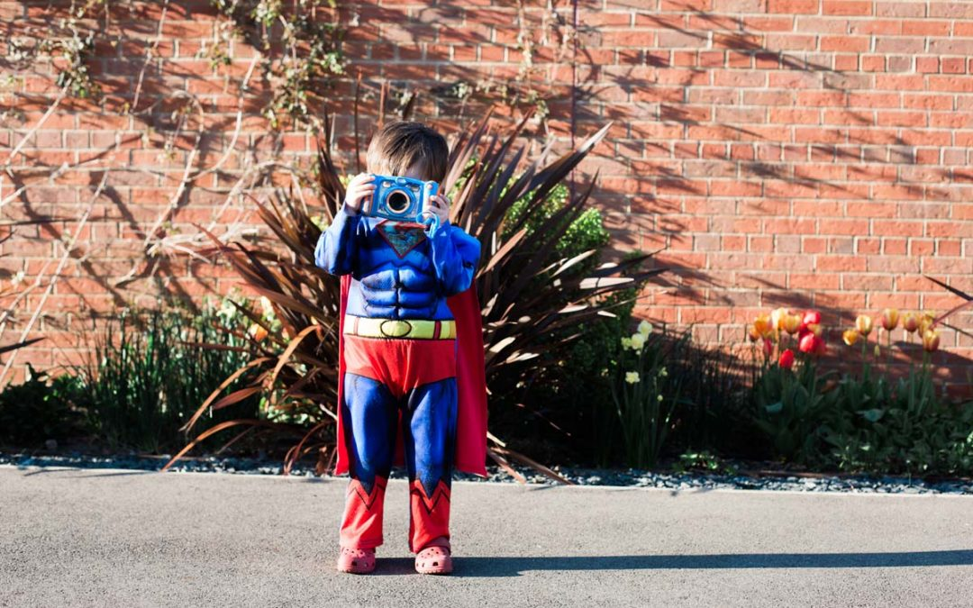 Fun family portrait of boy in Superman costume - Heni Fourie Photography